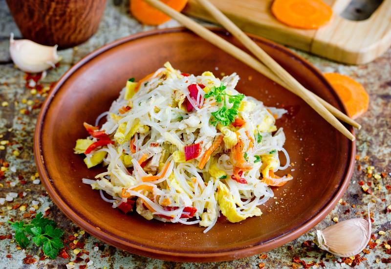 Chicken pad thai rice noodles with fried egg, onion, carrot, pepper. Chicken pad thai rice noodles with fried egg, onion, carrot royalty free stock photo