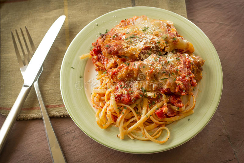 Chicken Parmesan with Linguine royalty free stock photos