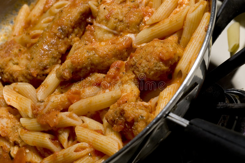 Chicken parmigiana and penne stock photos