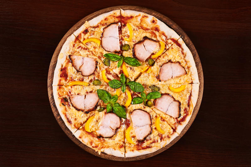 Chicken pastrami, yellow pepper and capers pizza stock image
