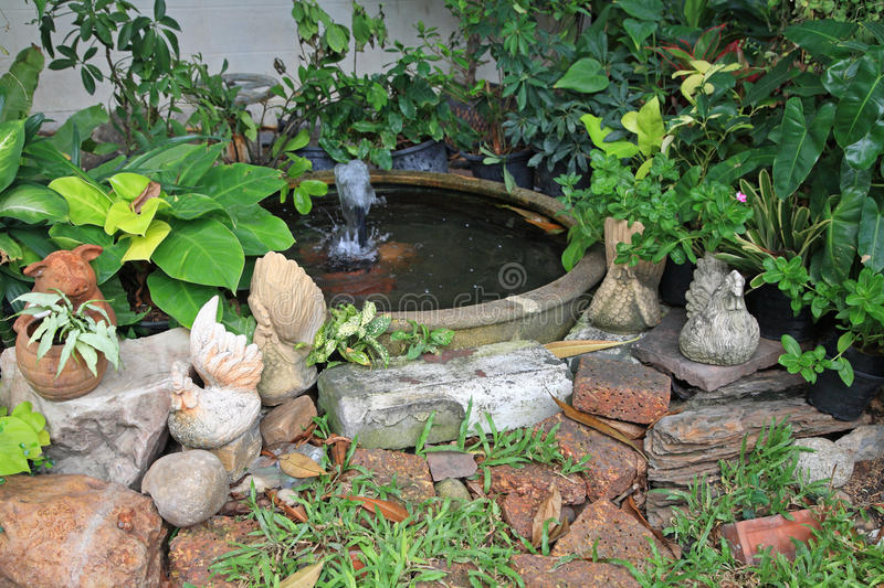 Download Chicken And Pig Statues At Earthenware Fountain In Garden Stock  Photo   Image: 41419262