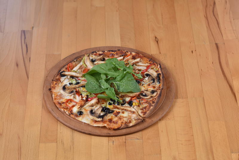 Chicken Pizza. Served on a wooden plate stock photos