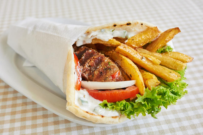 Chicken or pork wrap sandwich royalty free stock photography