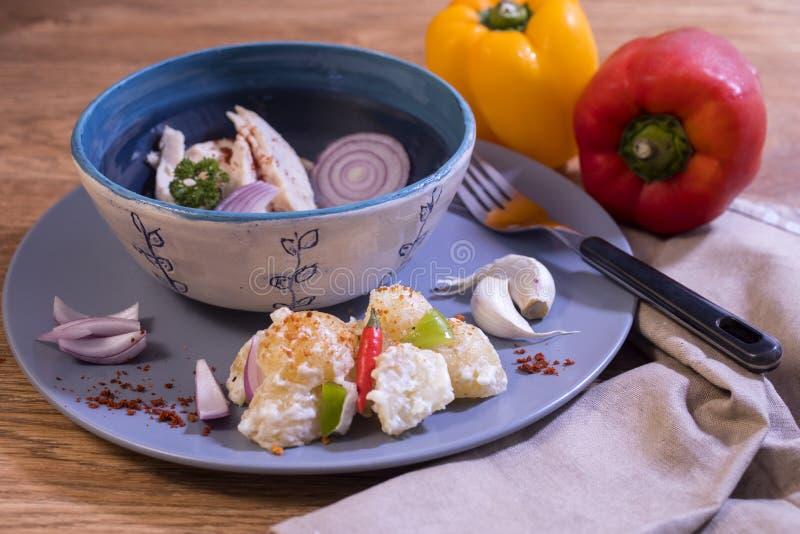 Healthy chicken dish and potato salad. royalty free stock image