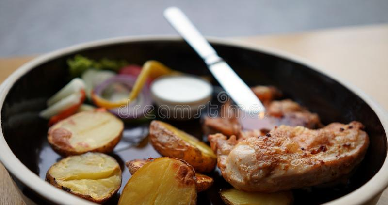 Chicken with potatoes royalty free stock photo