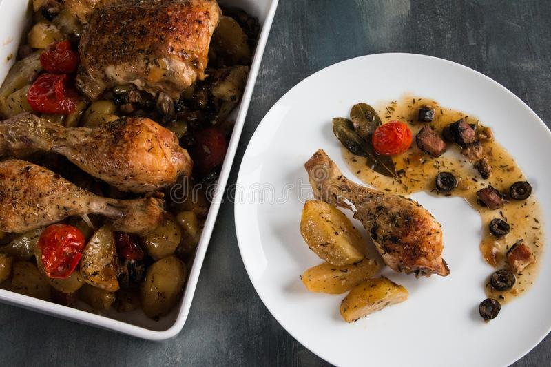 Chicken provencal homemade. The flavors are bold in this French sauté with a sauce of tomatoes, garlic, rosemary, olives, and just enough anchovy.Served on stock photos