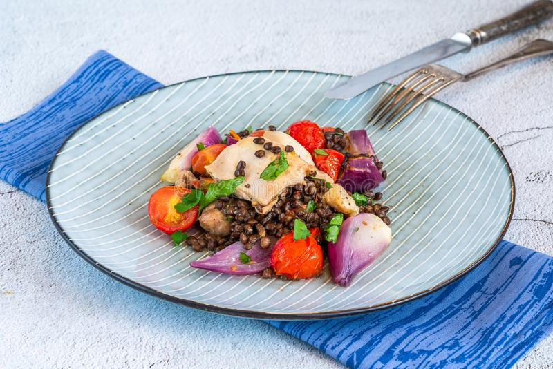Chicken, puy lentils and cherry tomatoes bake. Chicken and cherry tomatoes bake with puy lentils royalty free stock photos