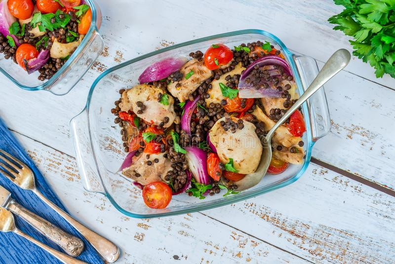 Chicken, puy lentils and cherry tomatoes bake. Chicken and cherry tomatoes bake with puy lentils - top view stock photos
