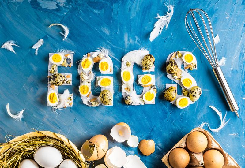 Chicken and quail eggs with word eggs stock images