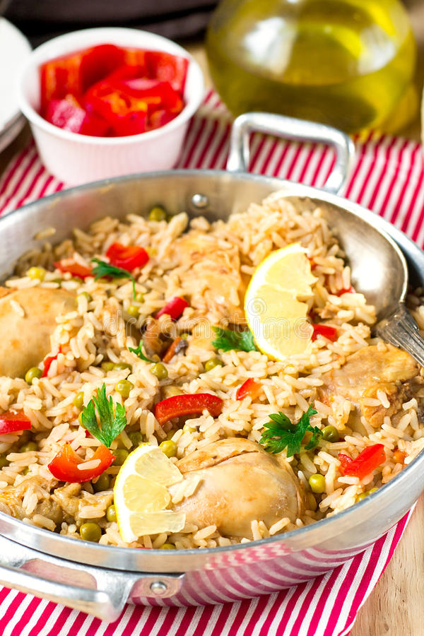 Chicken and rice with vegetables stock images