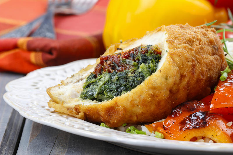 Download Chicken Roll Stuffed With Spinach And Dried Tomatoes Stock Photo - Image of filled, festive: 39508362