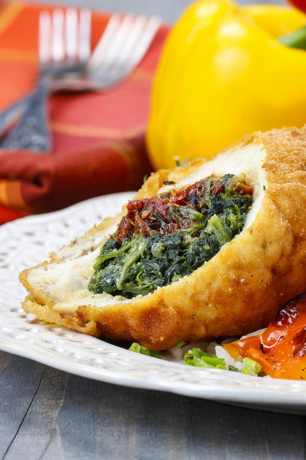 Download Chicken Roll Stuffed With Spinach And Dried Tomatoes Stock Photo - Image of cheese, dried: 39508432