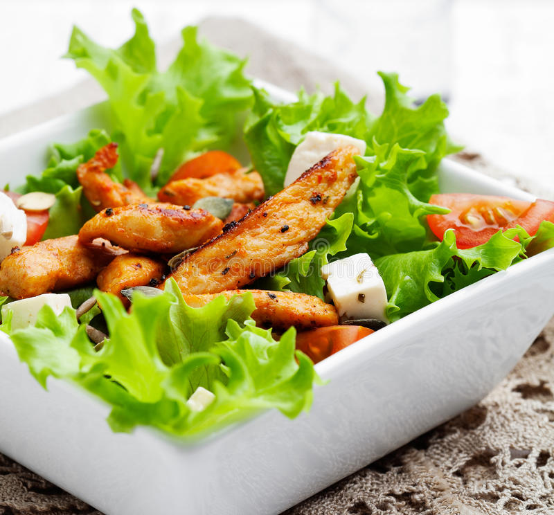 Chicken salad. Healthy salad with roasted chicken, tomatoes and feta stock photos