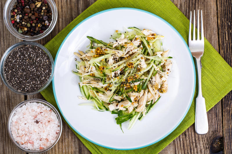 Chicken salad, fresh vegetables and chia seeds stock image