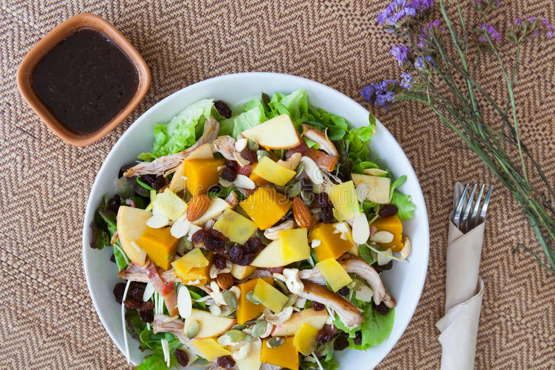 Chicken salad with roasted vegetables and mixed greens. royalty free stock photos