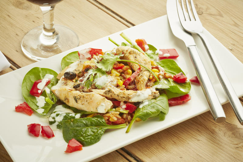 Chicken salad on white dish. And wooden table top stock photo