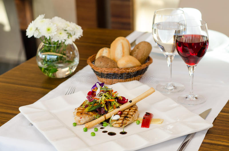 Chicken with salad and wine stock images