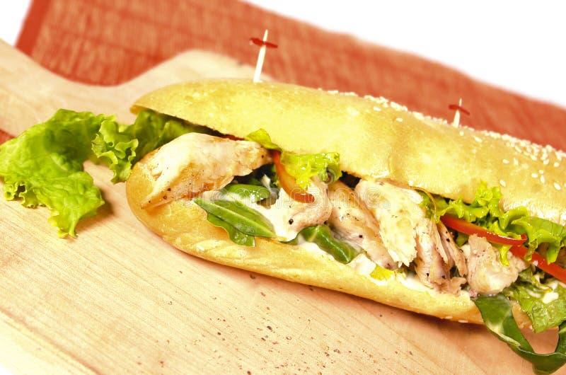 Chicken sandwich. Homemade chicken breast sandwich on baguette bread stock photos