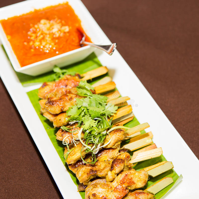 Chicken satay. Barbecue on white plate stock image