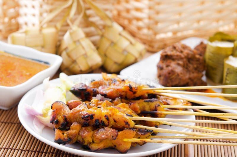 Chicken satay and ketupat. Chicken satay, ketupat or malay rice dumpling, lemang, rendang. Traditional Malay food, ramadan dish. Malaysian cuisine stock photos