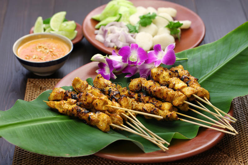 Chicken satay with peanut sauce, indonesian skewer cuisine royalty free stock photo