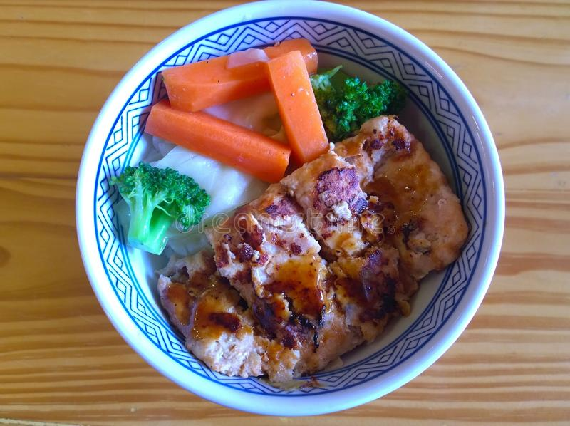 Chicken with sauce over rice stock photo
