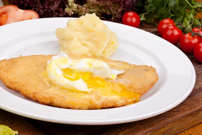 Chicken schnitzel with mashed potatoes on white plate royalty free stock photography