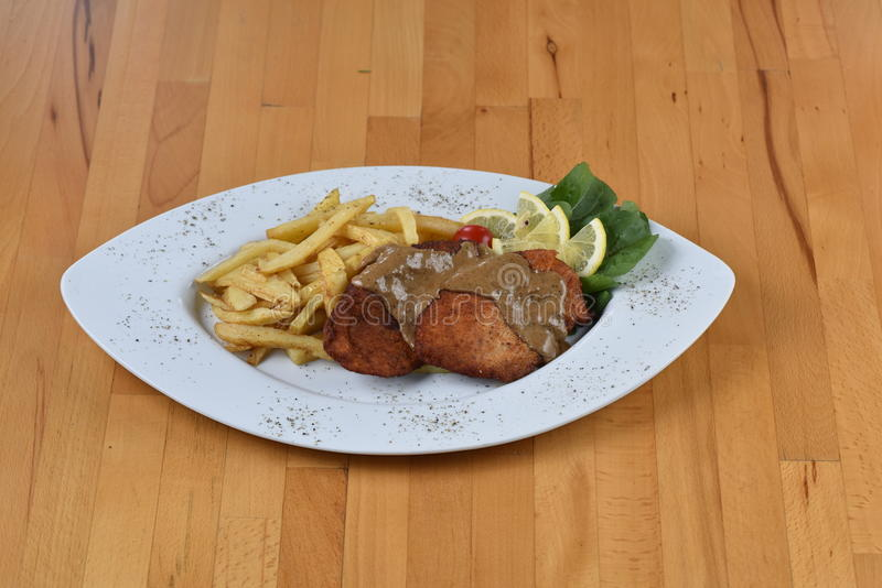 Chicken Schnitzel. Sandwich With Potato served on a wooden plate stock photography
