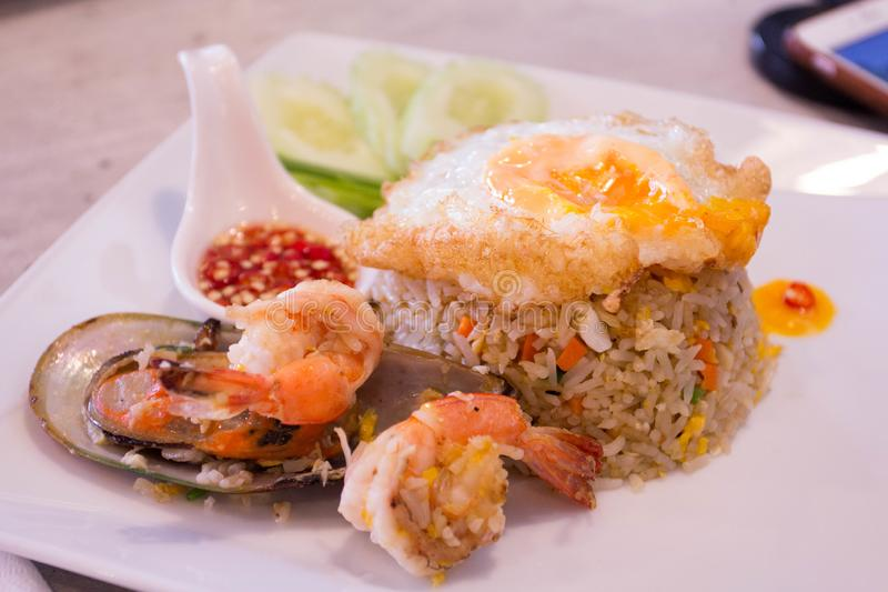 Chicken and seafood Fried Rice on dish royalty free stock images