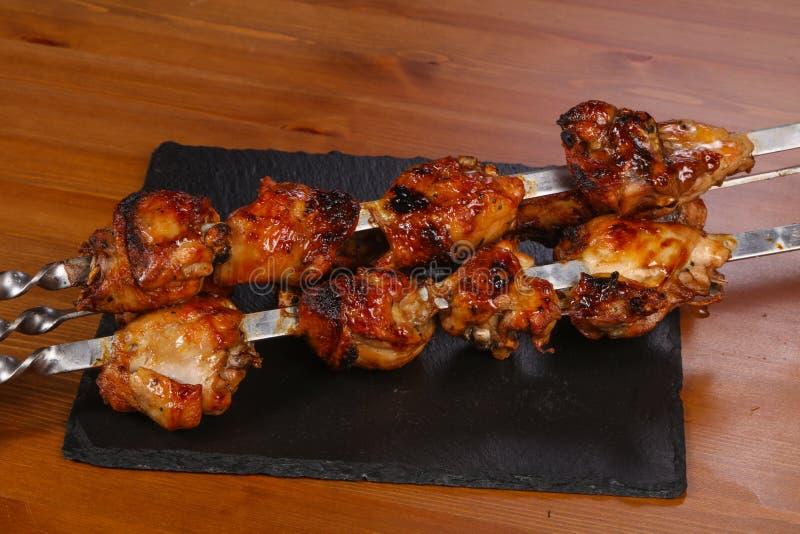 Chicken shashlik kebab on the sticks royalty free stock photos