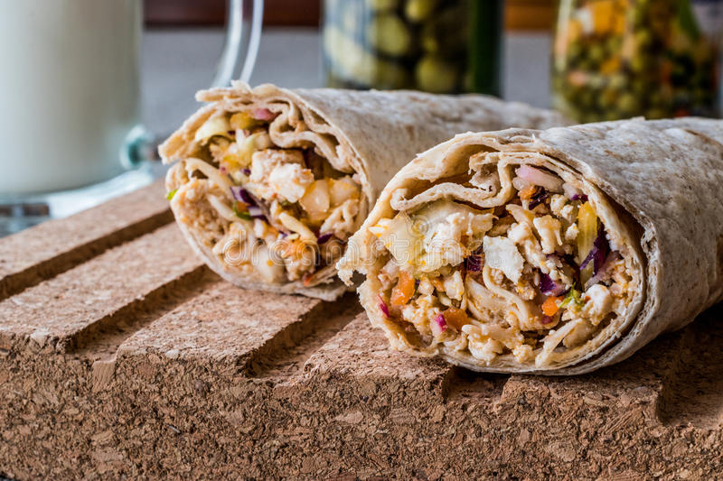 Chicken shawarma durum kebab with ayran or buttermilk / Tantuni. Fast food stock image