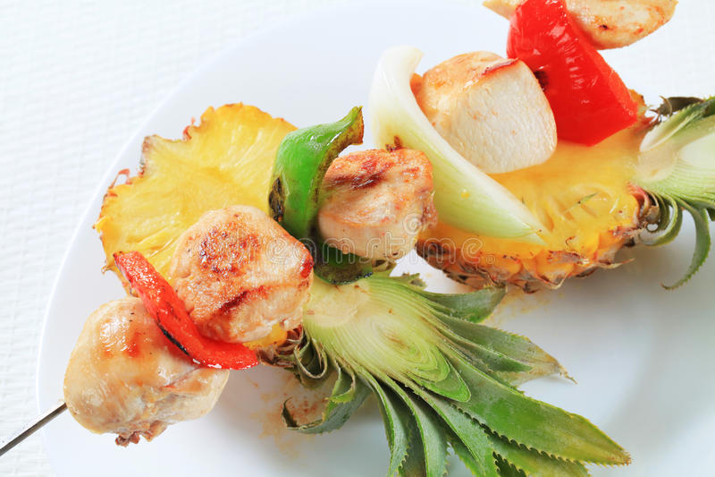 Chicken skewer and fresh pineapple stock images