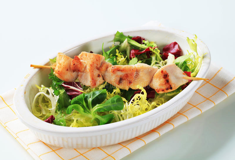 Chicken skewer and salad mix royalty free stock images