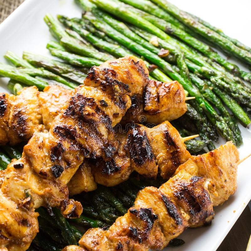 Chicken skewers with green asparagus stock photo