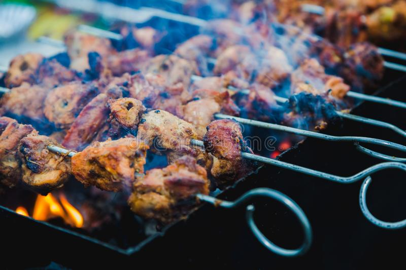 Chicken skewers grilling on a barbecue on top of charcoal grill stock photos