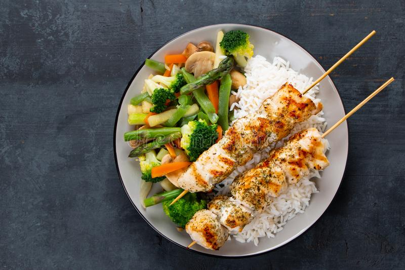 Chicken skewers with steamed vegetables and long rice royalty free stock photography