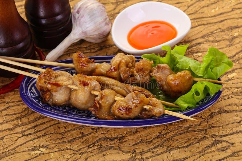 Chicken skin skewer stock images