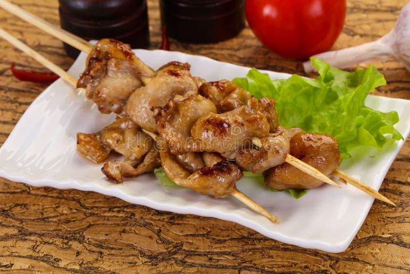 Chicken skin skewer stock photos