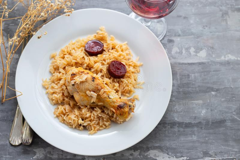 Chicken with smoked sausage and rice on white plate stock photos