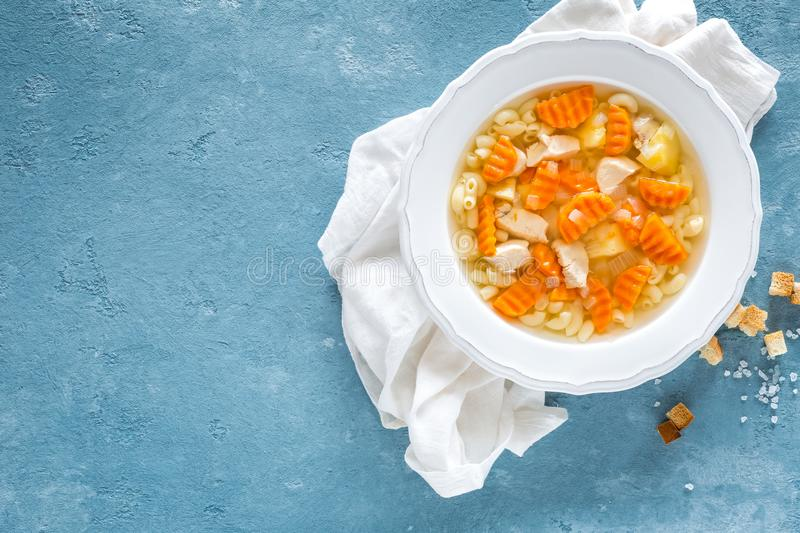 Chicken soup, bouillon with meat, pasta and vegetables stock photo