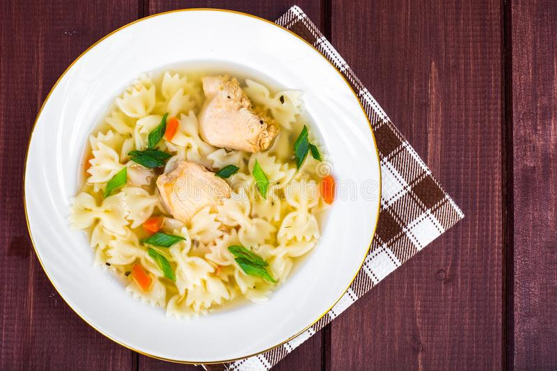 Chicken soup with meat and pasta royalty free stock image