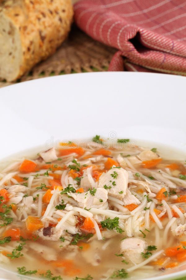 Chicken soup with pieces of meat royalty free stock image