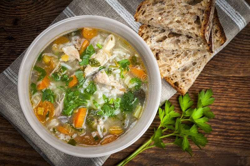 Chicken soup with rice and vegetables royalty free stock image