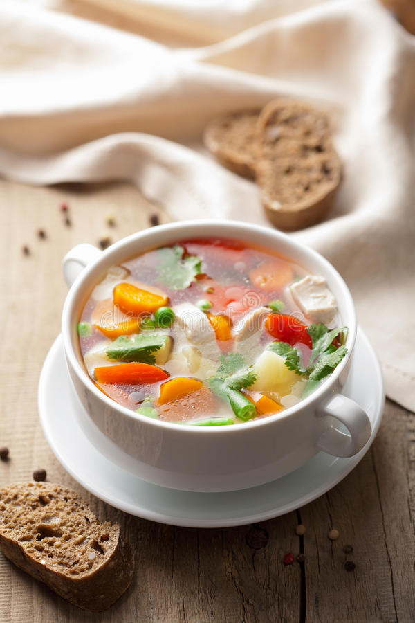 Chicken soup with vegetables stock photography