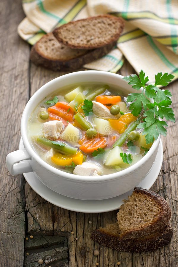 Chicken soup with vegetables stock image