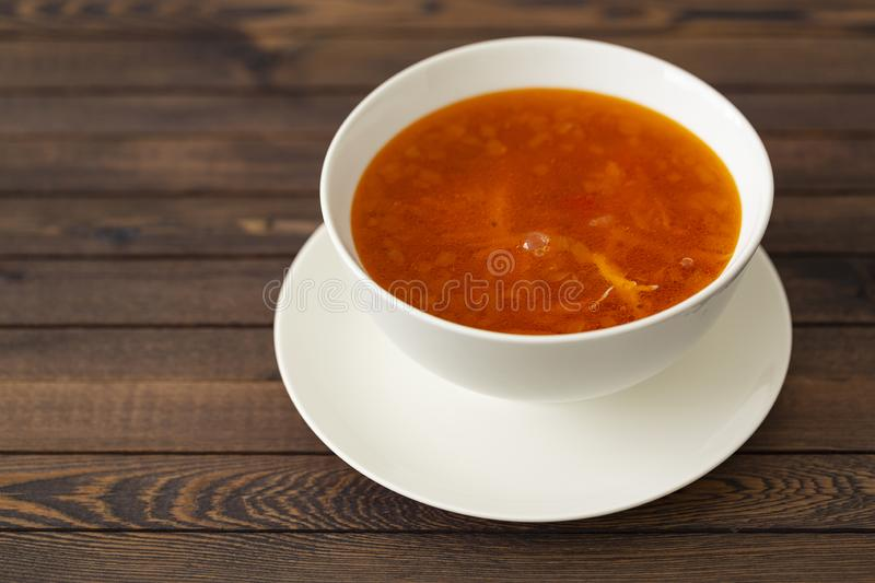 Chicken soup with vegetables and herbs in a white bowl stock photos
