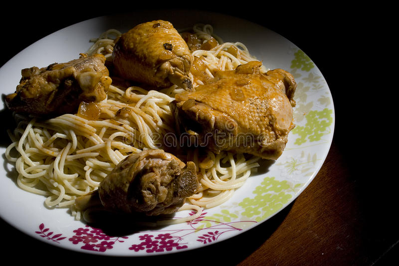 Chicken and spaghettis stock photography