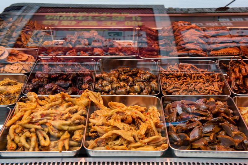 Chicken specialty food vendor. A chicken specialty food vendor in Shanghai sells all parts of cooked chicken for consumption stock images