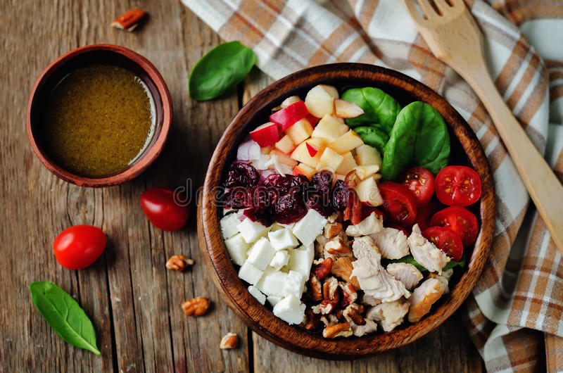 Chicken spinach apple tomato goat cheese salad. Toning. selective focus royalty free stock photography
