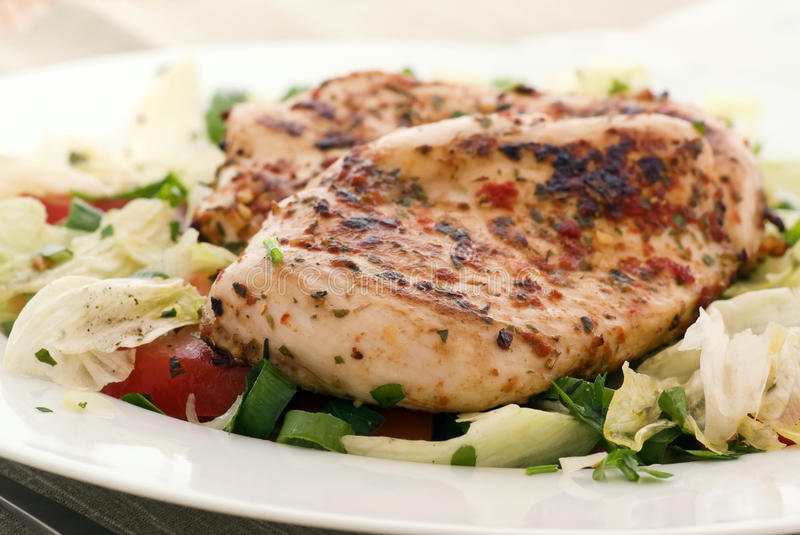 Chicken steak. With salad on a plate stock photography